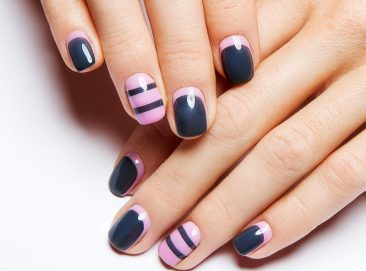 Beautiful women's manicure with gray and pink polish on